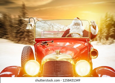 Santa Claus in red car and winter road with sunset time