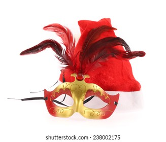 Santa Claus red hat and carnival mask  isolated on white background