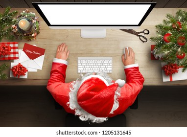 Santa Claus responds to letters and greeting cards via email. Isoalted display screen for mockup. Top view.