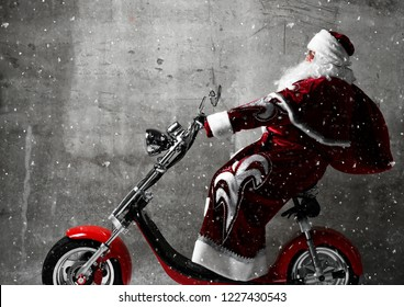 Santa Claus ride electric motorcycle bicycle scooter with bag full of presents and text copy space. New year and Merry Christmas and happy holidays concept