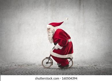 Santa Claus rides a bicycle