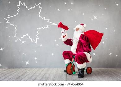 Santa Claus riding bicycle. Christmas Xmas holiday concept