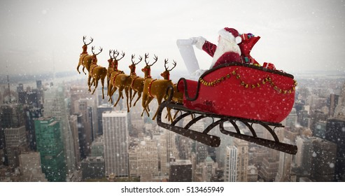 Santa Claus riding on sled during Christmas against city skyline