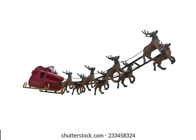 Santa Claus riding a sleigh led by reindeers isolated on white background