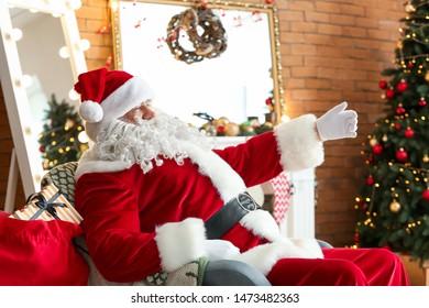 Santa Claus in room decorated for Christmas