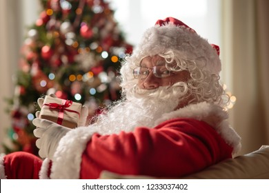 Santa Claus in a room on Christmas Eve