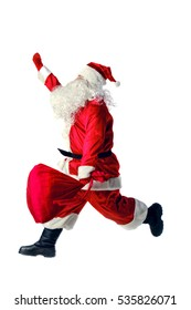 Santa Claus running with a bag of gifts. Santa Claus isolated on white.  Motion blur.