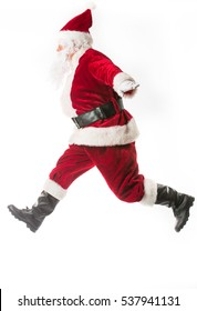 Santa Claus running with the bag of the presents isolated on white background