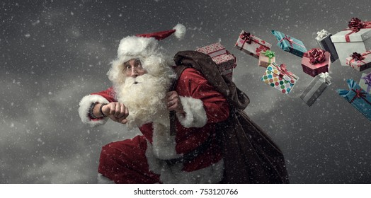 Santa Claus running and delivering presents on Christmas Eve: he is late and losing gifts from his sack