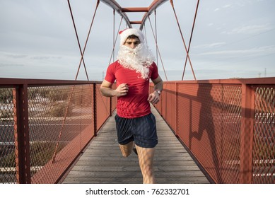 Santa Claus running on bridge for burn fat after christmas holidays