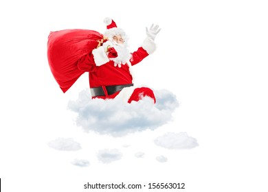 Santa Claus seated on cloud holding a bag full of presents and gesturing isolated on white background
