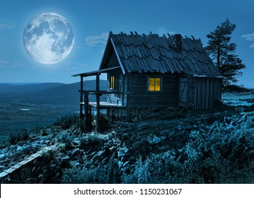 Santa Claus secret cottage on Lapland fell top in mysterious moonlight