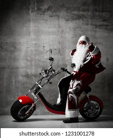 Santa Claus show thumbs up sign sitting on  electric motorcycle bicycle scooter with text copy space. New year and Merry Christmas and happy holidays concept