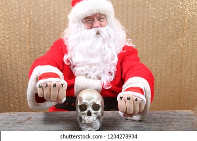 Santa Claus. Santa shows his knuckle tattoos which read Mery Xmas. Santa is one tough MF'er! Don't mess with santa.