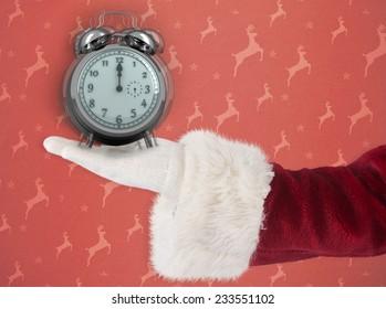 Santa Claus shows open hand against orange reindeer pattern