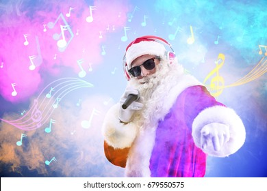 Santa Claus singing songs on blurred lights background. Christmas and New Year music