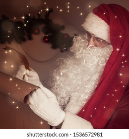 Santa Claus sitting at home and writing on old paper roll to do list with quill pen and ink