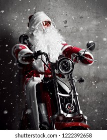 Santa Claus sitting on  electric motorcycle bicycle scooter with text copy space under snow. New year and Merry Christmas and happy holidays concept