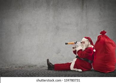 Santa Claus sitting on the floor looking through spyglass