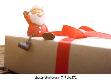 Santa claus sitting on gift box. Merry christmas.