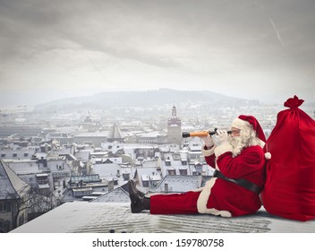 Santa Claus sitting over the city looking through spyglass