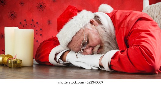 Santa Claus sleeping at desk against red snow flake background