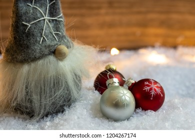 Santa Claus in the snow with Christmas tree balls