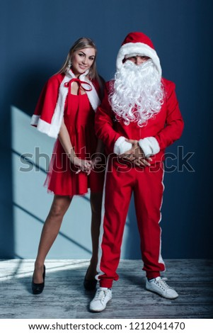 Santa Claus and Snow Maiden in festive Christmas outfits knocking on the  house - Santa Claus Snow Maiden Festive Christmas Stock Photo (Edit Now