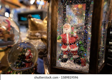 Santa Claus with snowflakes. Toy Christmas present. New Year's atmosphere of celebration and fun