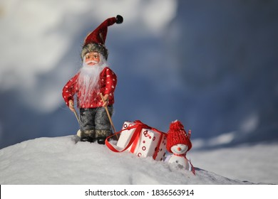 santa Claus and snowman with the gift