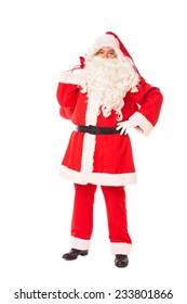 santa claus standing proud and holding his sack of gift on the back