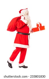 santa claus stepping quietly with his sack and gifts, isolated