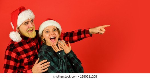 Santa Claus style. Having fun. Christmas time. Man and woman christmas holiday celebration. Family shopping. Christmas party. Couple in love cuddling. Good mood. Couple goals. Winter entertainment.