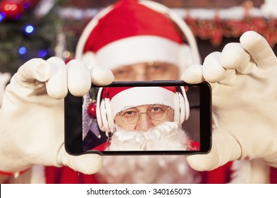 santa claus take a selfie with smart phone