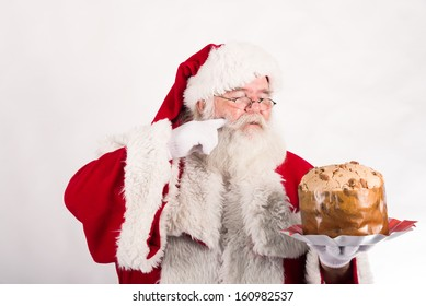Santa Claus tasting a traditional cake from Milan
