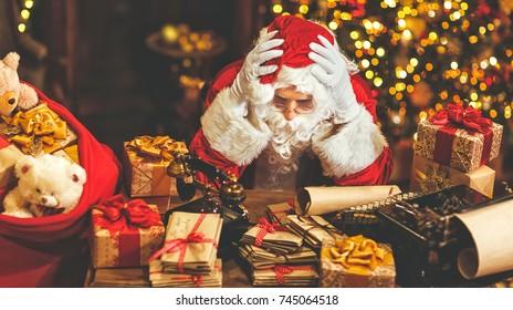 Santa Claus was tired under stress with a headache
