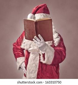 Santa Claus with vintage book