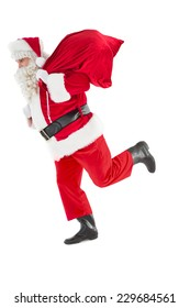 Santa claus walking with a sack on white background