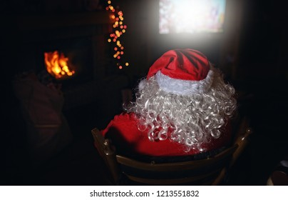 santa claus is watching TV in the cottage