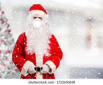 Santa Claus wearing a mask before Christmas, coronavirus concept