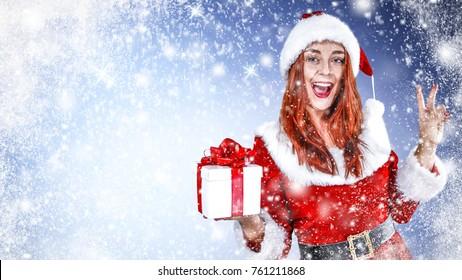 Santa claus woman and christmas gift