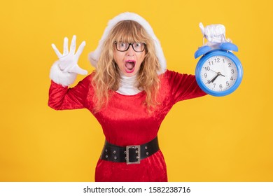 santa claus woman with clock or alarm isolated on color background