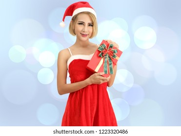santa claus woman in red clothes and hat with abstract background