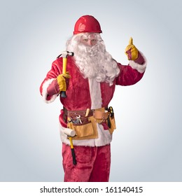 Santa Claus worker in helmet with hammer on an isolated background