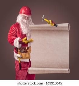 Santa Claus worker in helmet with scroll on brown background