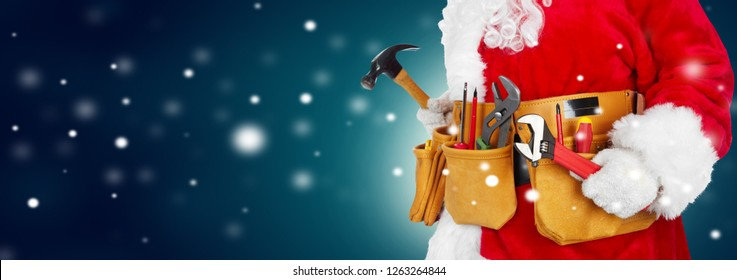 Santa Claus worker with a tool belt on winter background