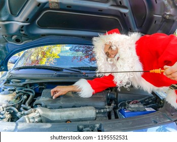 santa claus working in the car