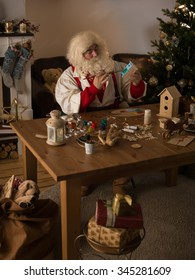 Santa Claus Working at Home. Making Toys for Children