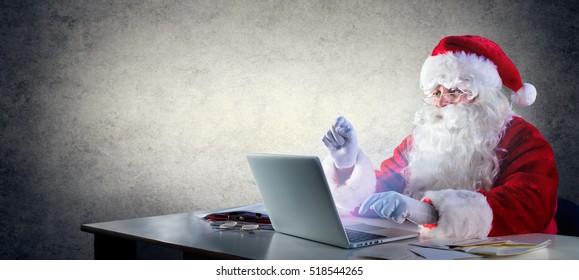 Santa Claus Writing With Laptop