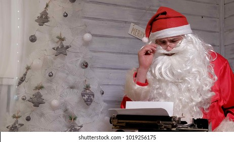 Santa Claus writing reply to a letter on a typewriter 4k